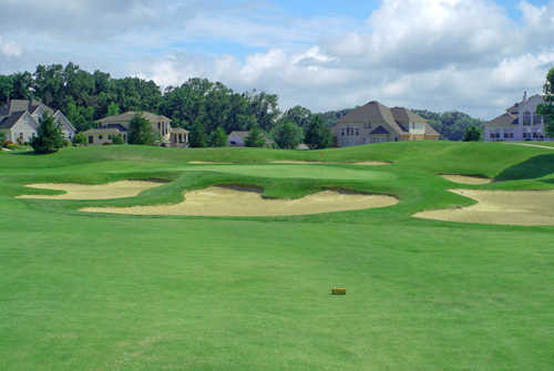 A view of green #11 surrounded by bunkers at Stonewolf Golf Club