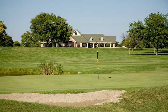 A view of a green with clubhouse in background at Hickory Point Golf Course