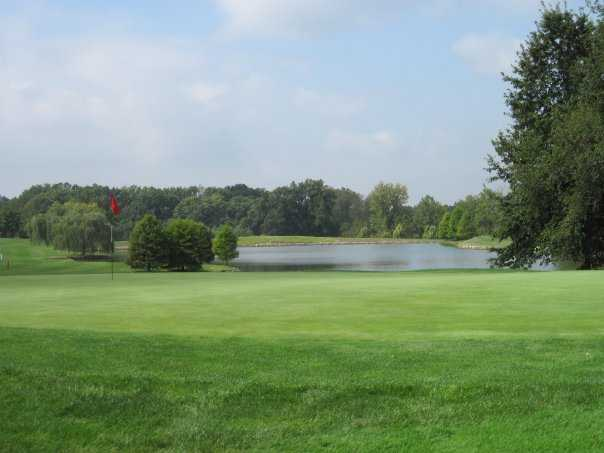 A view of hole #8 with water in background at Championship Course from Rolling Hills Golf Club