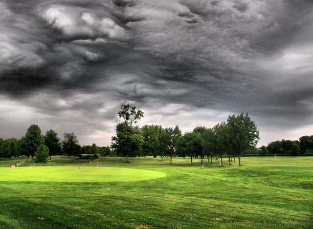 A cloudy view of the practice putting green at Rolling Hills Golf Club