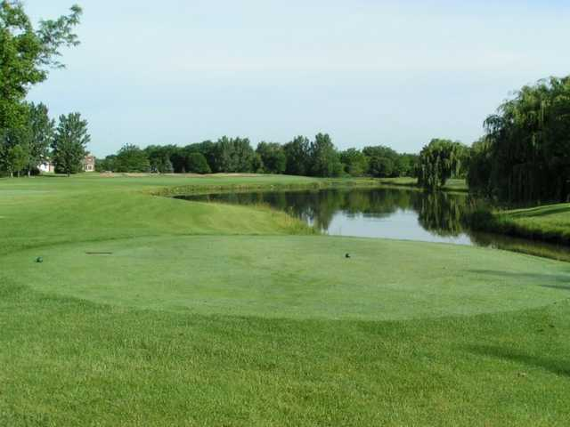 A view from tee with water on the right at Tamarack Golf Club