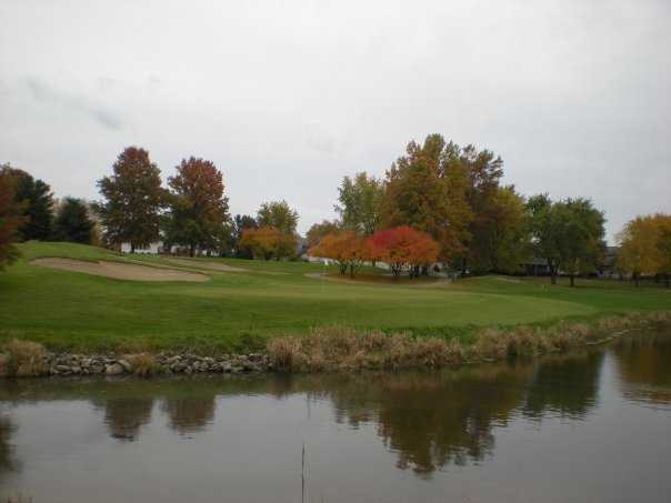 A view of green #17 surrounded by water at The Rail Golf Club