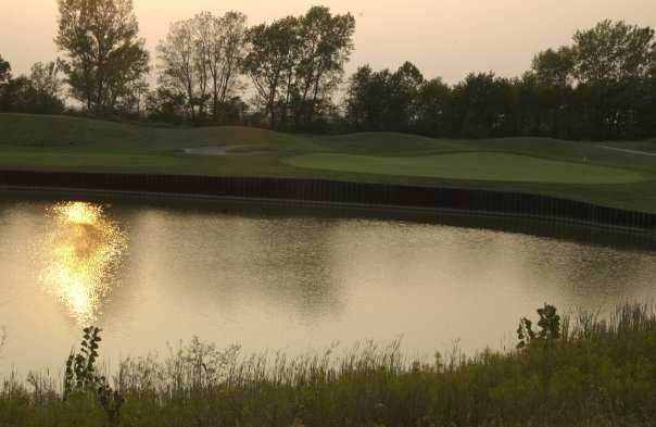 A view over the water of green #3 at Ironhorse Golf Course