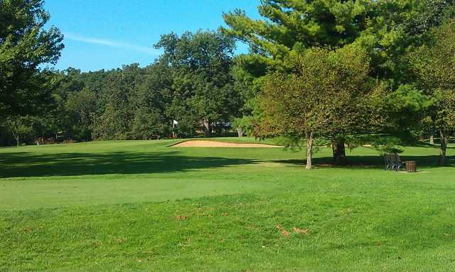 A view of a green with a bunker on the right at Bonnie Brook Golf Course