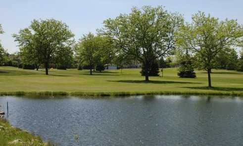 A view of green #4 from the left side of the pond at Zigfield Troy Golf Range & Par 3
