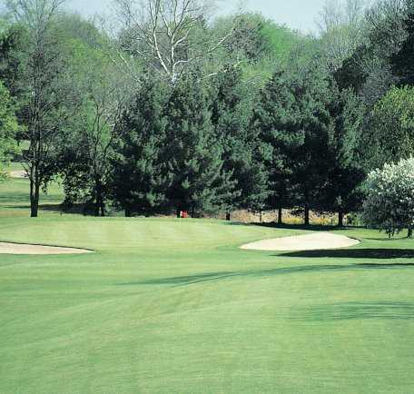 A view of a green protected by bunkers at Ashland Golf Club