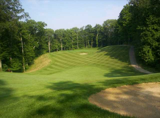 A view of a green with a narrow path on the right at Legendary Run Golf Club