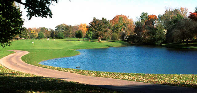 A fall view of a green with water coming into play from right at Beckett Ridge Country Club