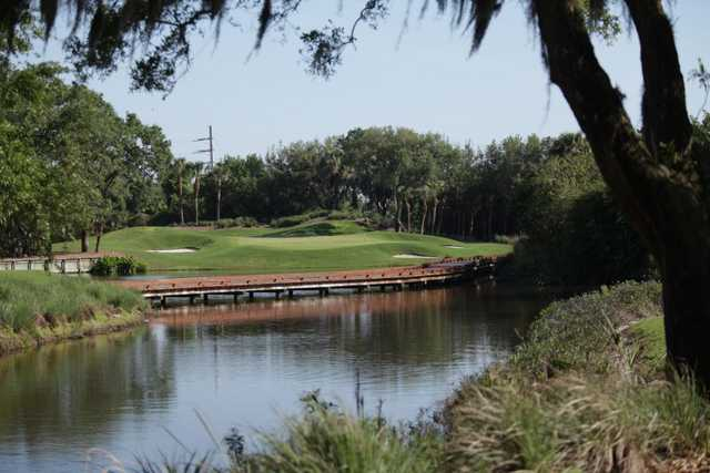 A view over the water of a green at Oaks Club