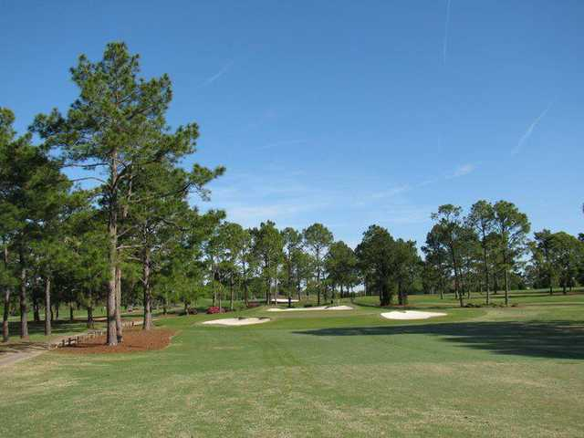 A view of green 8 protected by bunkers at Seminole Legacy Golf Club