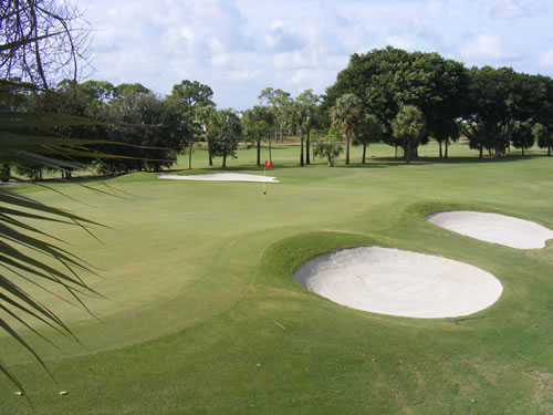 A view of green guarded by bunkers at Tequesta Country Club