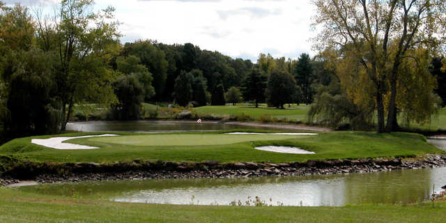 A view of a green surrounded by water at Blue Fox Run Golf Club