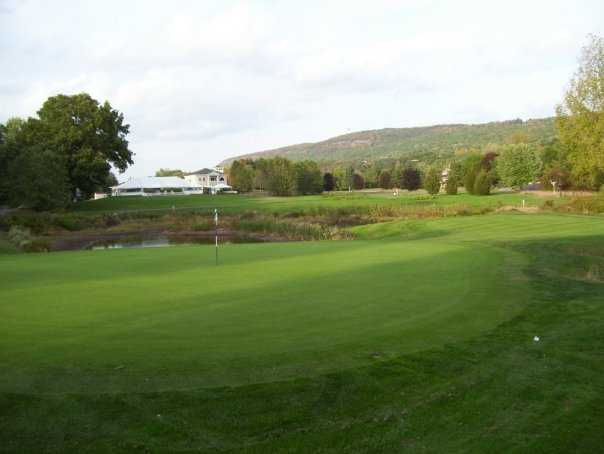 A view of a hole with water in background at Blue Fox Run Golf Club