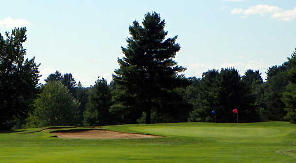 A view of a hole with a bunker on the left at East Hartford Golf Club