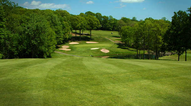 A view of a green surrounded by bunkers at Laurel View Country Club