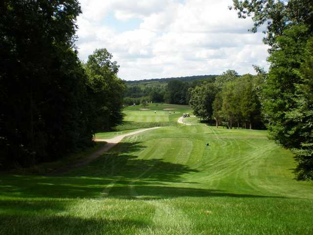 A view from fairway with cart path on the left at River Ridge Golf Course