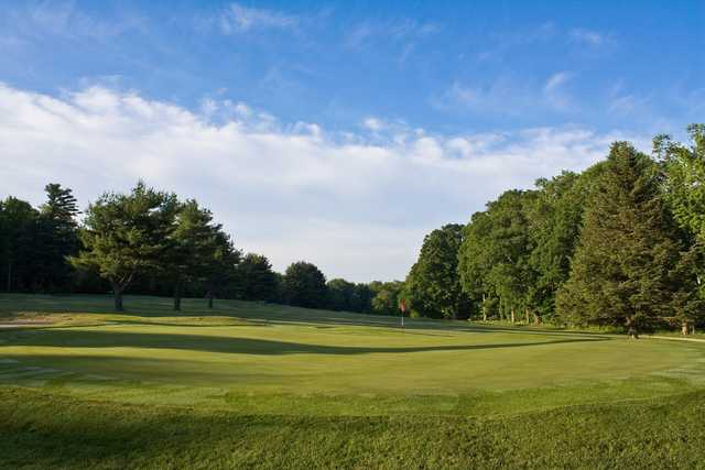 A view of the 9th green at Green Woods Country Club