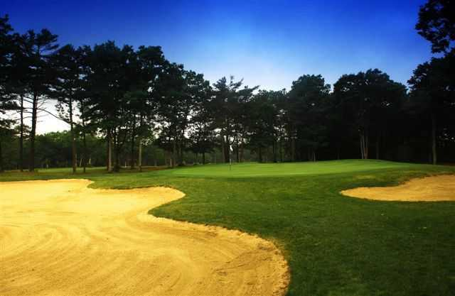 A view of green #12 protected by bunkers at Falmouth Country Club - Eighteen Hole