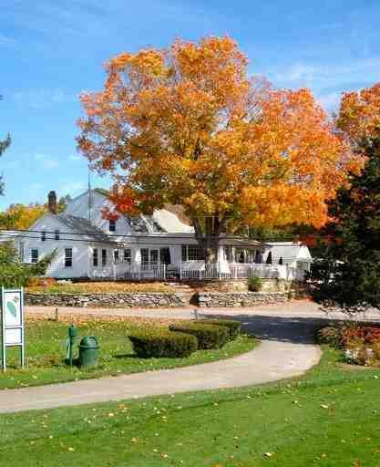 A fall view of the clubhouse at Foster Country Club