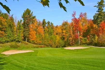 A view of green 13 flanked by bunkers at Glacier Wood Golf Club