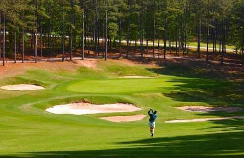 A view of a green protected by bunkers from The Golf Club at Cedar Creek.