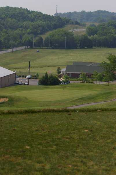 A view from tee #7 of the clubhouse and driving range at Country Hills Golf Club