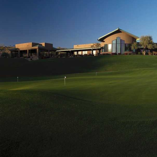A view of the clubhouse and putting green at Eagle Mountain Golf Club