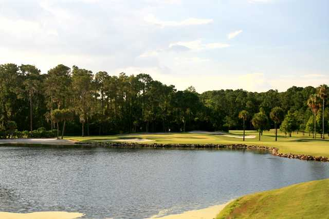 The par-3 16th hole on the Palm golf course at Disney World offers a pretty shot over water from an elevated tee.