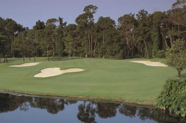 The par-3 sixth hole on the Magnolia Course at Walt Disney World has the signature Mickey Mouse bunker in front of the green.