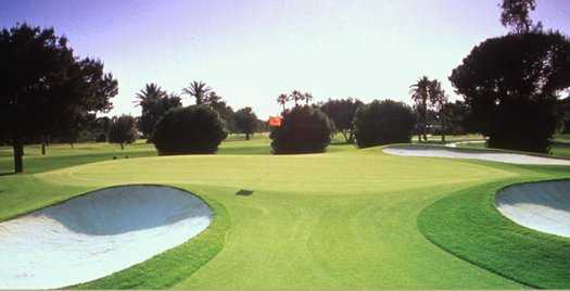 A view of a green protected by bunkers at Blue Course from Wigwam Resort