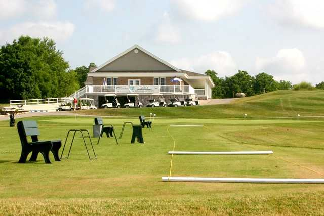 A view of the driving range and clubhouse in background at Willow Wood Golf Club