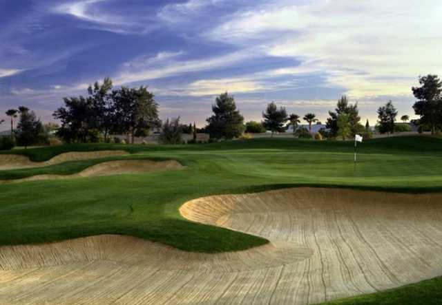 A view of green protected by bunkers at Corte Bella Golf Club