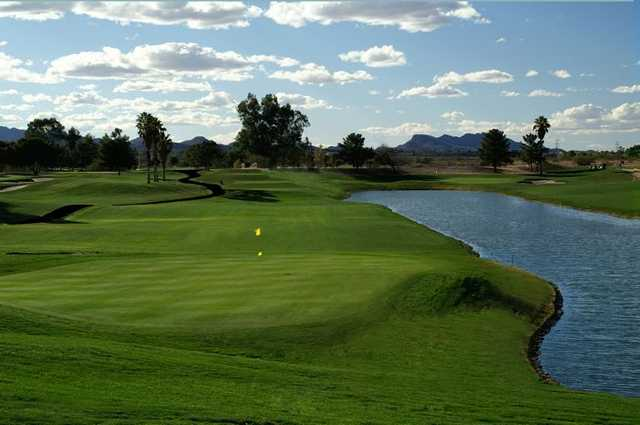 A view of a green with water coming into play at Silverbell Golf Course.