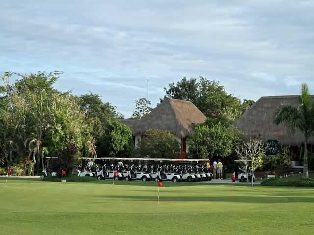 A view of the clubhouse and putting green at Cozumel Country Club