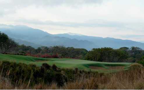 A view of a green protected by bunkers at Nicklaus Course from Vista Vallarta Golf Club