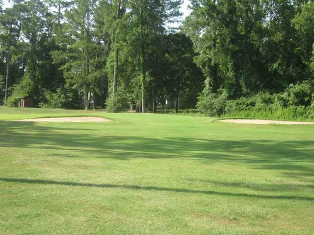 A view of green flanked by bunkers at Livingston Golf Course