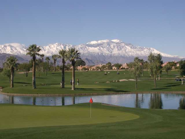 Indian Springs GC: #18 green in foreground with #15 green and hole on the other side of the lake. Mt. San Jacinto covered in snow in the background