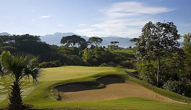 A view of a green protected by bunker at Weiskopf Course from Vista Vallarta Golf Club