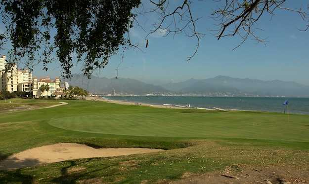 A view of a green with water coming into play at Nicklaus Course from Vista Vallarta Golf Club