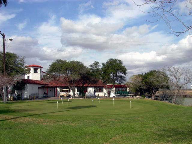 A view of the clubhouse and putting green at Llano Grande Golf Course