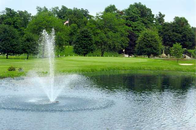 A view of a green with water fountain in foreground from Frankfort Commons Golf Course
