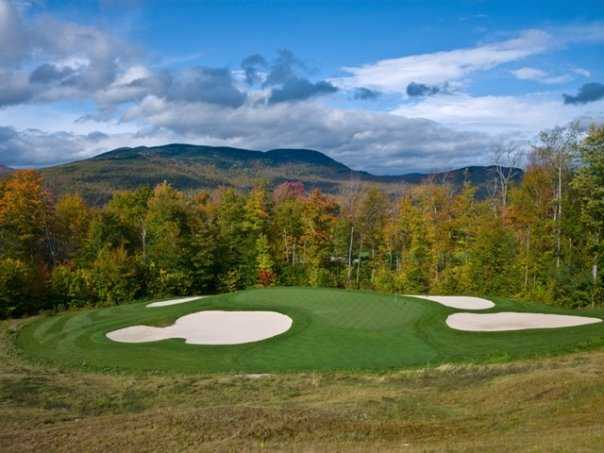 A view from the 16th green protected by bunkers at Sunday River Golf Club