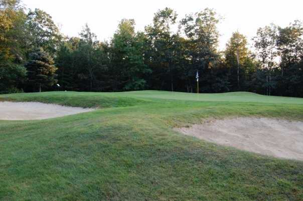 A view of green #2 surrounded by bunkers at Wilson Lake Country Club