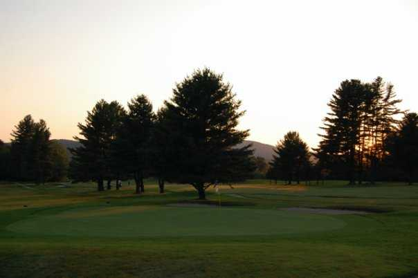 A sunset view of the 9th green at Wilson Lake Country Club