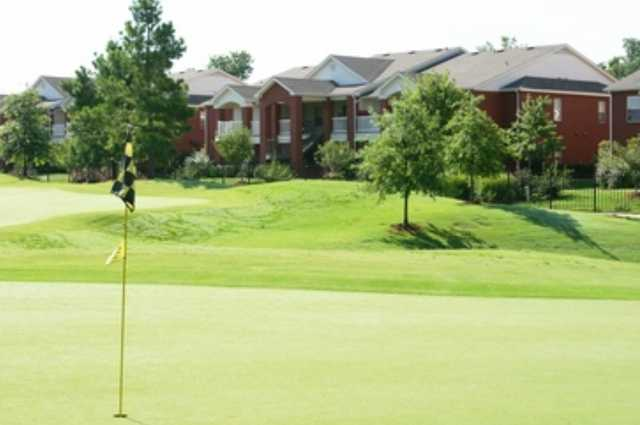 A view of the clubhouse with green in foreground (courtesy of Lindsey Management)