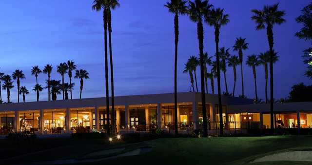 An evening view of the clubhouse at Eldorado Country Club.
