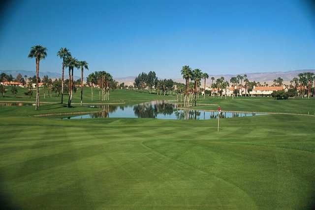 A view of green with water coming into play at Desert Falls Country Club