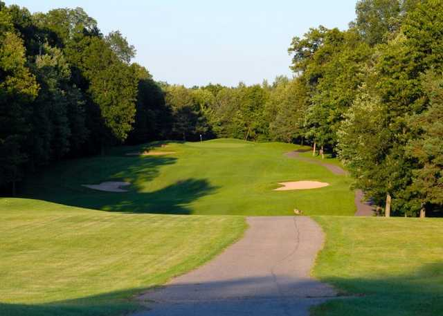 A view of green with narrow path on the right at Timber Ridge Golf Course