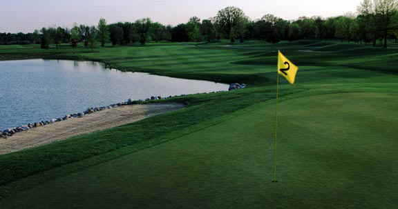 A view of a green with water coming into play at Oak Ridge Golf Club (Joe Wilssens Photography, Inc.)