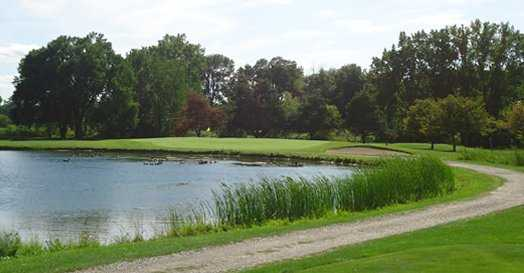 A view over the water of green at Whiteford Valley Golf Club